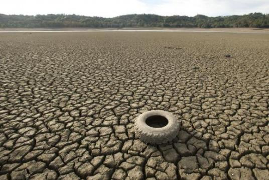 A tire rests on the dry bed of Lake Mendocino, a key Mendocino County reservoir, in Ukiah